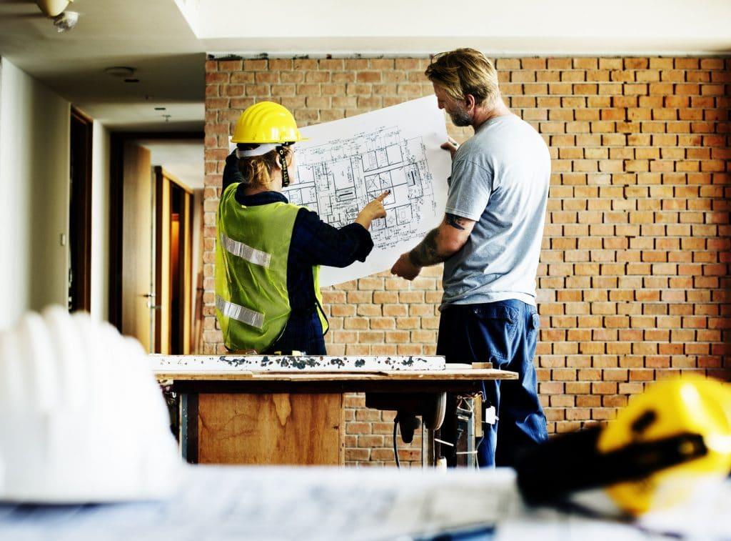 Construction team working on a blueprint